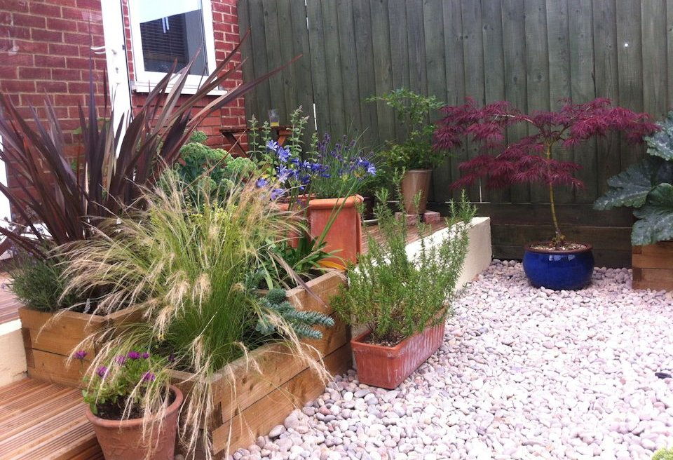 Garden planting norwich mn landscapes garden project for Garden decking norwich
