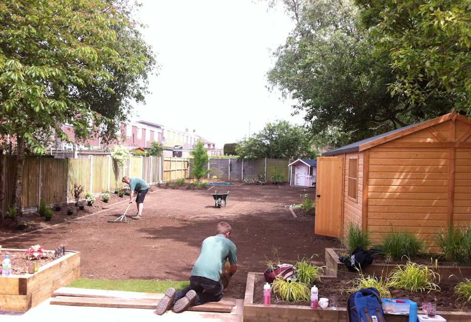 Garden Design Gorleston, Norfolk - Levelling the soil ready for new turf